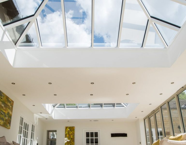 Glass roof panels pictured from inside a house