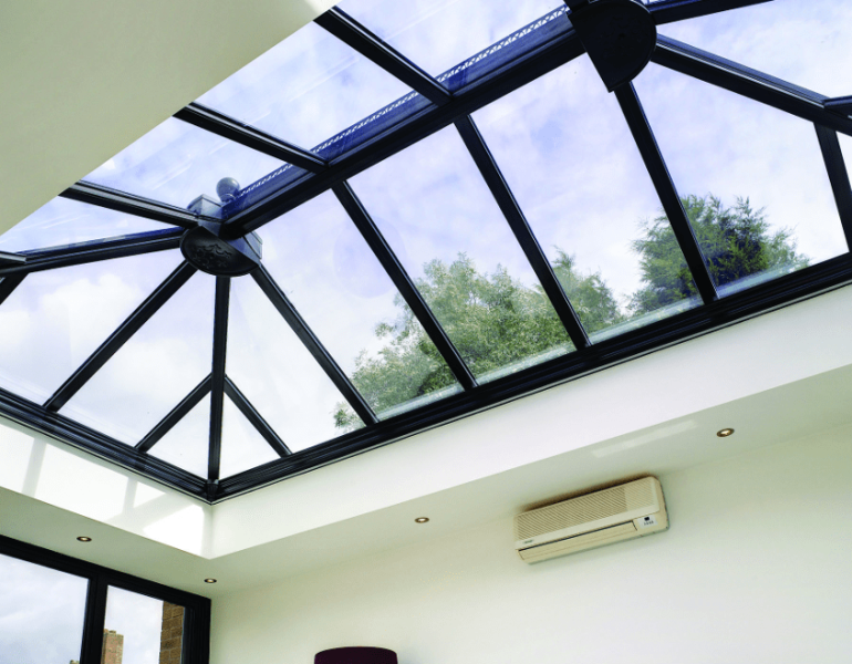 conservatory glass roof with dark coloured frame