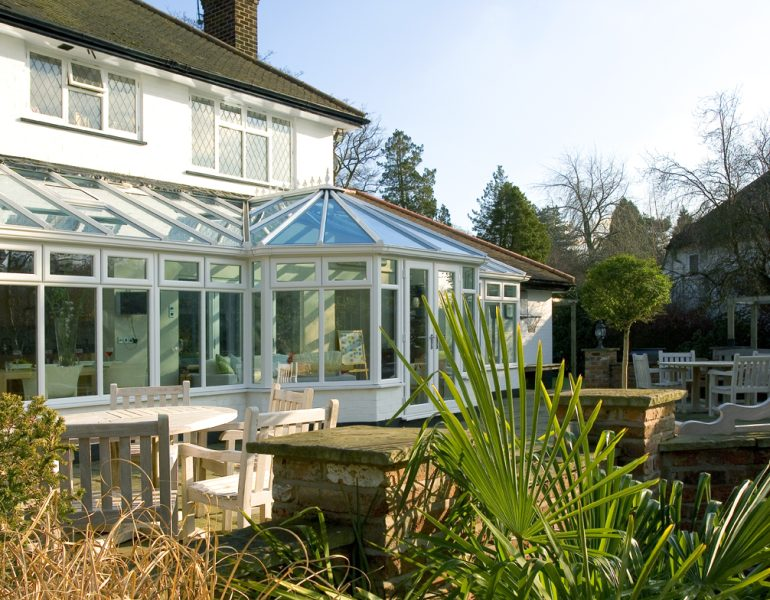 garden view of a glass roof conservatory