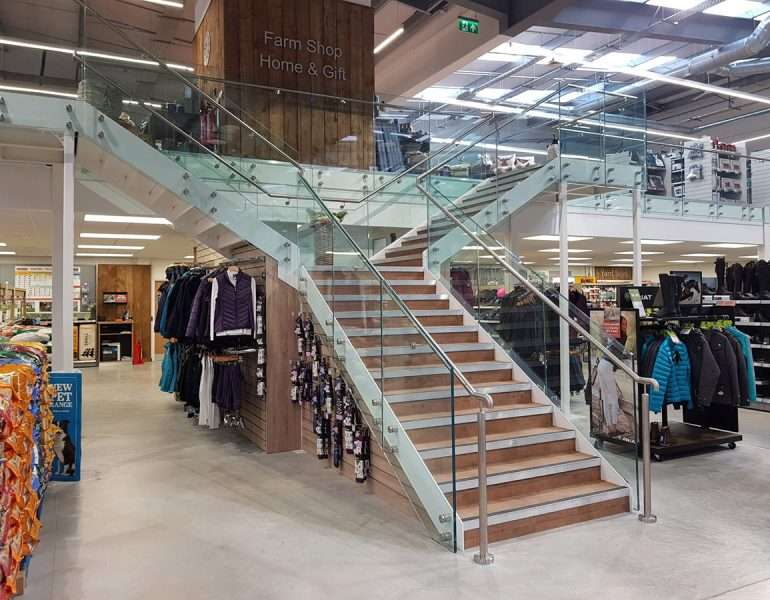 Heat strengthened glass balustrade railings in a shop