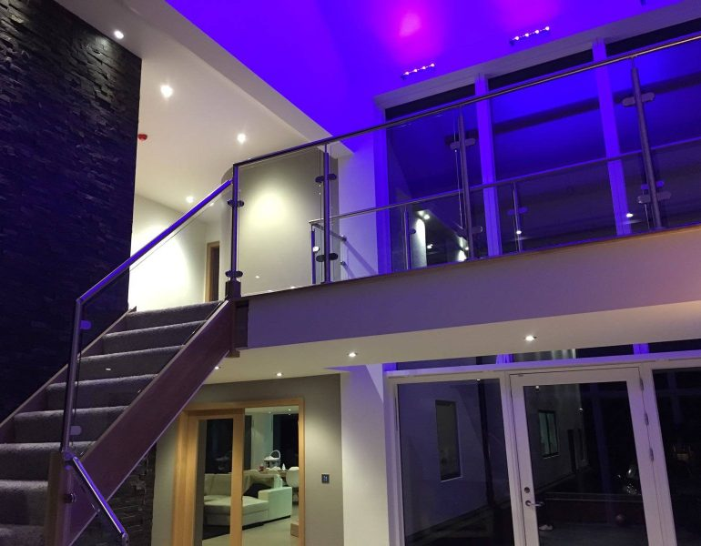 home staircase with glass balcony and balustrades