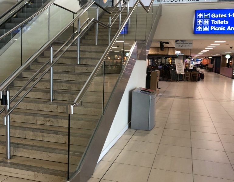 John Lennon airport stair glass balustrades