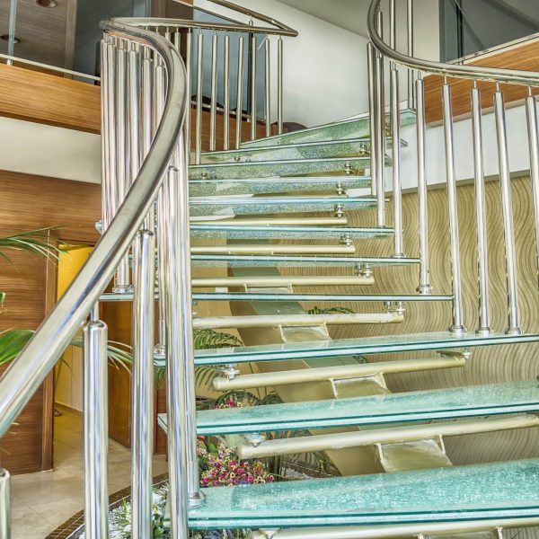 sweeping staircase laminated cracked glass