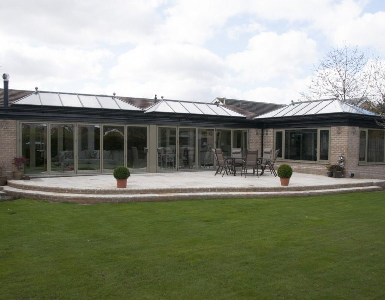 triple glass roofed orangery